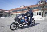"""Ersetzt so manches Auto: ein vollgefedertes Lastenrad mit elektrischer Antriebsunterstützung. Hier ein Modell der Serie """"Load"""" des Darmstädter Herstellers Riese und Müller; ausgestattet mit einem Bosch-Mittelmotor und Zusatzkomponenten zum Kindertransport."""