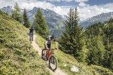 Sonne, Berge, Panorama - und ein Traum von einem Trail. Viel schöner kann Mountainbiken nicht sein.