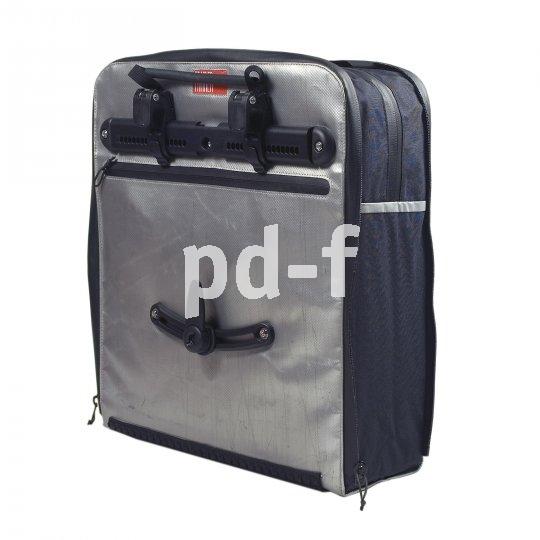Aktuelle Gepäckträgertaschen halten dank spezieller Adapter bombenfest am Rad, auch bei ruppiger Gangart über innerstädtisches Kopfsteinpflaster oder Bordsteinkanten.