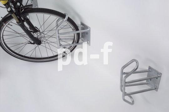 Solche Fahrradhalter lassen sich einfach an der Hauswand befestigen.