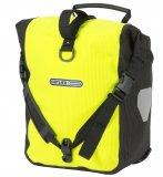 Mit auffälliger Farbe und einem speziellen reflektierenden Material macht sich diese Gepäcktasche um die passive Sicherheit verdient.