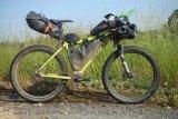 Auf einem entsprechend belastbaren Fahrrad lässt sich in sogenannten Rahmentaschen einiges an Gepäck unterbringen, ohne dass das Fahrverhalten leidet.